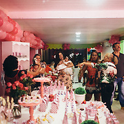 Lis's first birthday, Carol's daughter. Lis has congenital syndrome of Zika virus. Carol, belonging to a leisure class, is one of the few mothers affected by Zika virus could afford to organize a party for her little girl.