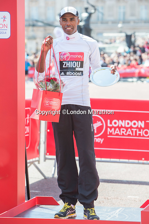 Men's IPC Marathon Cup T11-13 race runner-up Abderrahim Zhiou of Tunisia n the podium at the Virgin Money London Marathon 2014 at the finish line on Sunday 13 April 2014<br />