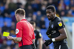 March 23, 2019 - Meadow, Shropshire, United Kingdom - Referee Ollie Yates gives Omar Bogle of Portsmouth FC a yellow card during the Sky Bet League 1 match between Shrewsbury Town and Portsmouth at Greenhous Meadow, Shrewsbury on Saturday 23rd March 2019. (Credit Image: © Mi News/NurPhoto via ZUMA Press)