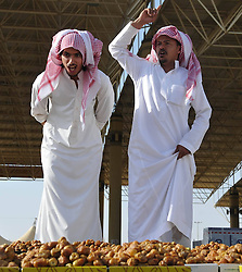 60366649  <br /> Salesmen cry their wares at the worlds biggest date palm market in Buraidah, some 300 km north of Riyadh, capital of Saudi Arabia, Aug. 18, 2013. There are 23 million date palm trees in Saudi Arabia, while the annual output of date palms amount to millions of tons, Sunday, August 18, 2013. <br /> Picture by imago / i-Images<br /> UK ONLY
