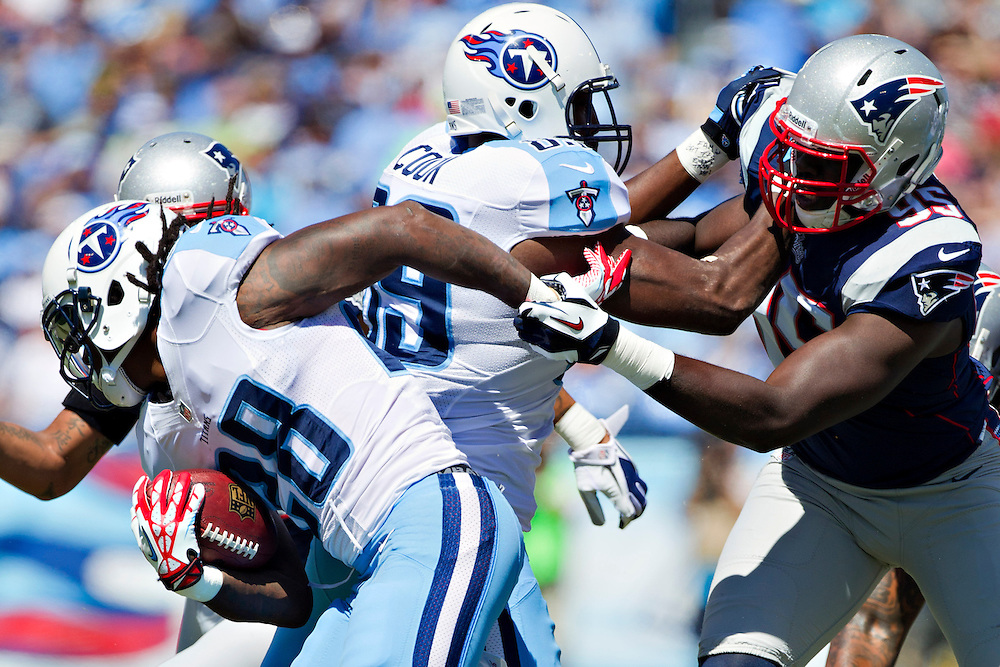 NASHVILLE, TN - SEPTEMBER 9:  Chris Johnson #28 of the Tennessee Titans runs the ball during the season opener against the New England Patriots at LP Field on September 8, 2012 in Nashville, Tennessee.  The Patriots defeated the Titans 34 to 13.  (Photo by Wesley Hitt/Getty Images) *** Local Caption *** Chris Johnson