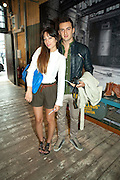 LEONARDO BORDIGONI; VERONICA FALCO, Design Your Own Timberland breakfast and Autumn/ Winter 2011 preview. Timberland. 1 Fournier St. London. Followed by an art tour by Julia Royce. 8 June 2011. <br /> <br />  , -DO NOT ARCHIVE-© Copyright Photograph by Dafydd Jones. 248 Clapham Rd. London SW9 0PZ. Tel 0207 820 0771. www.dafjones.com.