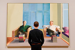 "© Licensed to London News Pictures. 06/02/2017. London, UK. A staff member views ""Christopher Isherwood and Don Bachardy"" at the preview of the world's most extensive retrospective of the work of David Hockney at the Tate Britain, which will be on display 9 February to 29 May 2017. Photo credit : Stephen Chung/LNP"