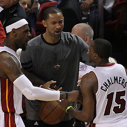 Jun 21, 2012; Miami, FL, USA; Miami Heat small forward LeBron James (6) talks to point guard Mario Chalmers (15) on the sidelines during the third quarter in game five in the 2012 NBA Finals at the American Airlines Arena. Mandatory Credit: Derick E. Hingle-US PRESSWIRE