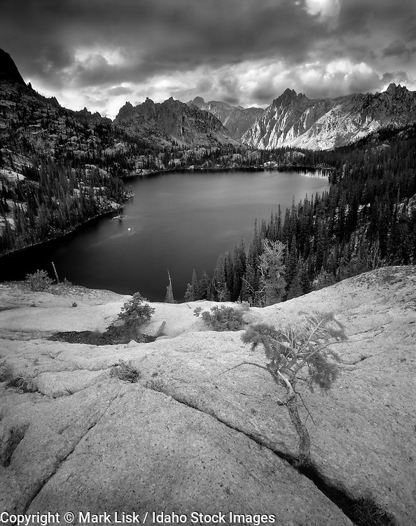 Storm clouds travel high over the rugged granite Sawtooth peaks above Barron Lake.