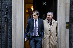© Licensed to London News Pictures. 08/01/2019. London, UK. Conservative Chief Whip Julian Smith (L) and Attorney General Geoffrey Cox QC (R) leave 10 Downing Street. Photo credit: Rob Pinney/LNP
