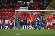 AFC Wimbledon goalkeeper Joe McDonnell (24) saving the ball during the EFL Sky Bet League 1 match between Charlton Athletic and AFC Wimbledon at The Valley, London, England on 15 December 2018.