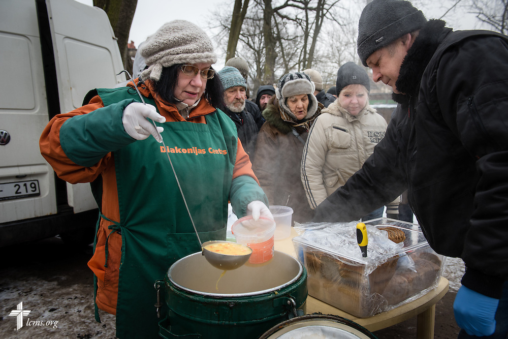 Ilze Juhnevia with the Diaconia Center of The Evangelical Lutheran Church of Latvia doles out hot soup to area residents and homeless on Thursday, Feb. 5, 2015, in Riga, Latvia. LCMS Communications/Erik M. Lunsford