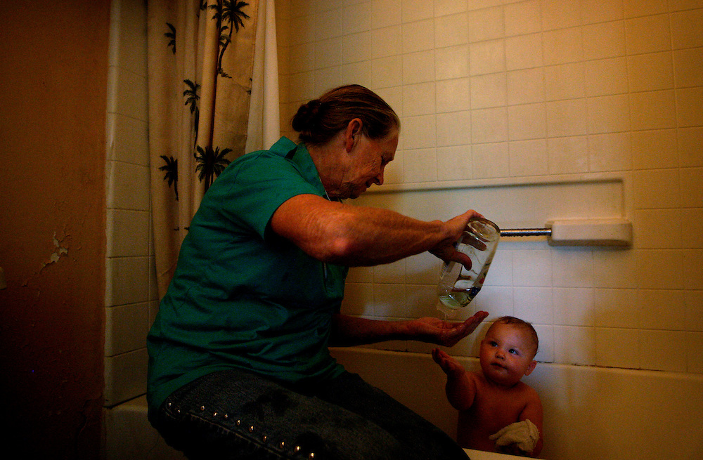 "Caleb Huth, 1, mimics his great-grandmother Katherine Smith as he is given a bath after getting covered in grass while playing in the sprinkler. ""God has answered so many prayers for me I can't begin to name them for you,"" Smith said. Greg Kahn/Staff"