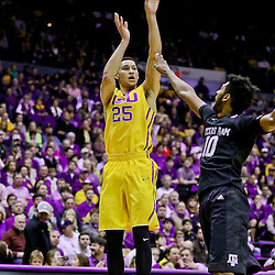 Feb 13, 2016; Baton Rouge, LA, USA; LSU Tigers forward Ben Simmons (25) shoots over Texas A&M Aggies center Tonny Trocha-Morelos (10) during the first half of a game at the Pete Maravich Assembly Center. Mandatory Credit: Derick E. Hingle-USA TODAY Sports