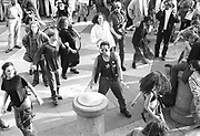 Ravers dancing among crowd, 1st Criminal Justice March, Trafalgar Square, London, UK, 1st of May 1994.