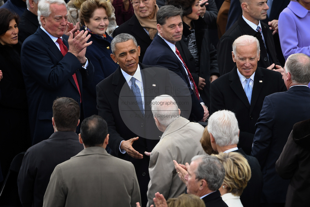 President Barack Obama greets former President Jimmy Carter after he arrived for the President Inaugural Ceremony on Capitol Hill January 20, 2017 in Washington, DC. Donald Trump became the 45th President of the United States in the ceremony.