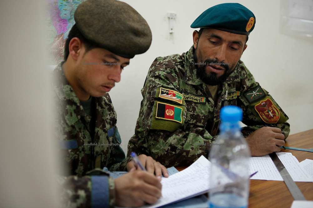 ANA soldiers doing administrative work in Camp Pamir, Kunduz.