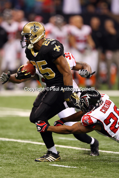 NEW ORLEANS - DECEMBER 07: Running back Reggie Bush #25 of the New Orleans Saints runs the ball during the game against the Atlanta Falcons at the Louisiana Superdome on December 7, 2008 in New Orleans, Louisiana. The Saints defeated the Falcons 29-25. ©Paul Anthony Spinelli *** Local Caption *** Reggie Bush