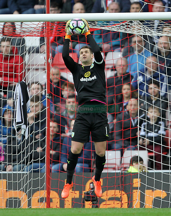 Burnley goalkeeper Tom Heaton makes a save