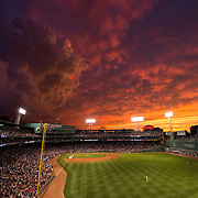 BOSTON, MA - JUNE 23: A dramatic sunset illumines the sky during a game between the Boston Red Sox and the Baltimore Orioles at Fenway Park in Boston, Massachusetts on June 23, 2015. (Photo by Michael Ivins/Boston Red Sox/Getty Images) *** Local Caption *** Fenway Park