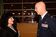 Judy Brinegar of Baldwin Creative & Company (left) and Col. Zane E. Brown of the Ohio Air National Guard during the Dayton Development Coalition annual meeting in the Schuster Center in downtown Dayton, Wednesday, January 11, 2012.