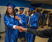Graduating seniors parade through the halls of  Westbury High School, May 23, 2016.