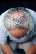 top of head view of balding senior man