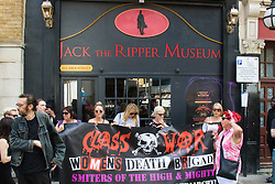 Cable Street, London, August 22nd 2015. Activists from Class War demonstrate against the newly established Jack The Ripper Museum on Cable Street, claiming that it demeans women by profiting off the death of prostitutes killed by the Ripper. The Museum, during its planning stage, claimed that it would be dedicated to the Suffragettes movement.