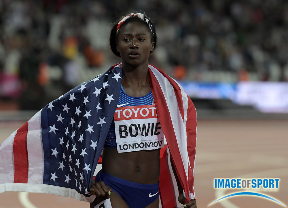 Aug 6, 2017; London, United Kingdom; Tori Bowie (USA) takes a victory lap with United States flag after winning the women's 100m in 10.85 during the IAAF World Championships in Athletics at London Stadium at Queen Elizabeth Park.