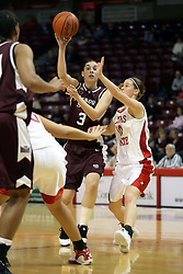 13 January 2007: Melissa Busby passes before Kristi Cirone can get into position for a block. The Missouri State Bears lost to the Redbirds of Illinois State University at Redbird Arena in Normal Illinois by a score of 76-47.<br />