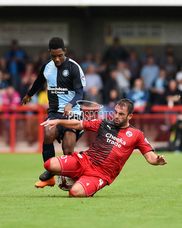 Wycombe's Jason Banton is tackled by Crawley's Simon Walton during the Sky Bet League 2 match between Crawley Town and Wycombe Wanderers at the Checkatrade.com Stadium, Crawley, England on 29 August 2015. Photo by David Charbit.