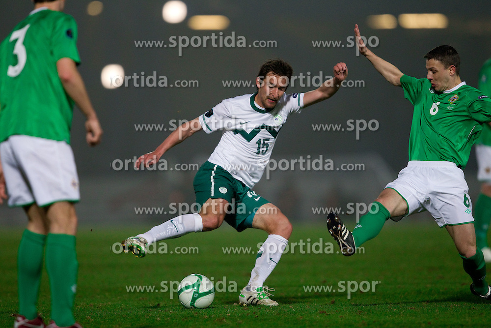 Armin Bacinovic of Slovenia vs Chris Baird during EURO 2012 Quaifications game between National teams of Slovenia and Northern Ireland, on March 29, 2011, in Windsor Park Stadium, Belfast, Northern Ireland, United Kingdom. (Photo by Vid Ponikvar / Sportida)