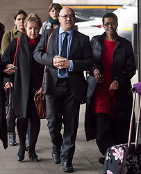 © Licensed to London News Pictures. 20/02/2018. London, UK. Chair of Oxfam trustees CAROLINE THOMSON, Oxfam CEO, MARK GOLDRING and Oxfam International executive director WINNIE BYANYIMA arrive at Portcullis House in London where Oxfam bosses are due to give evidence to an International Development Select Committee. The group will respond to allegations that prostitutes were hired by Oxfam workers during a humanitarian mission in Haiti. Photo credit: Ben Cawthra/LNP