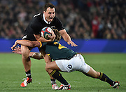JOHANNESBURG, South Africa, 04 October 2014 : Israel Dagg of the All Blacks is tackled by Pat Lambie of the Springboks during the Castle Lager Rugby Championship test match between SOUTH AFRICA and NEW ZEALAND at ELLIS PARK in Johannesburg, South Africa on 04 October 2014. <br /> The Springboks won 27-25 but the All Blacks successfully defended the 2014 Championship trophy.<br /> <br /> © Anton de Villiers / SASPA