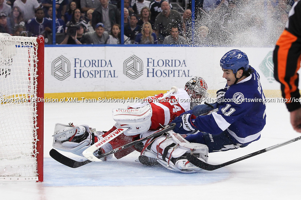 16 April 2015: Tampa Bay Lightning center Brian Boyle (11) gets the puck past Detroit Red Wings goalie Petr Mrazek (34) for a goal in the 1st period of Game 1 of the First Round of the Stanley Cup Playoffs between the Detroit Red Wings and Tampa Bay Lightning at Amalie Arena in Tampa, FL.