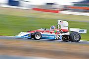 Car No 82 heads around Luffield. Silverstone Classic - 66-85 F1- 25/7/10.