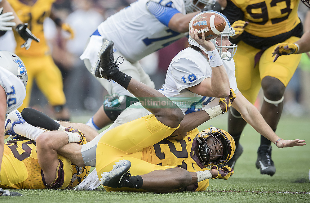 September 16, 2017 - Minneapolis, MN, USA - Minnesota linebackers Kamal Martin, bottom right, and Carter Coughlin team up to bring down Middle Tennessee quarterback John Urzua during the second quarter at TCF Bank Stadium, Saturday, Sept. 16, 2017, in Minneapolis. The host Gophers won, 34-3. (Credit Image: © Elizabeth Flores/TNS via ZUMA Wire)