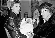 The baby daughter of Brendan and Beatrice Behan is christened Blanaid Orla Jacqueline Mairead at St Andrew's Church, Westland Row. Blanaid, in full voice, and wrapped in a 200-year-old Limerick lace shawl, is held by her godmother, Celia Salkeld (sister of Beatrice Behan) and watched over by her grandparents, Stephen and Kathleen Behan..02.12.1963
