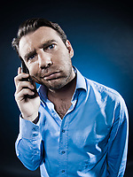 caucasian man frown bored at phone unshaven portrait isolated studio on black background