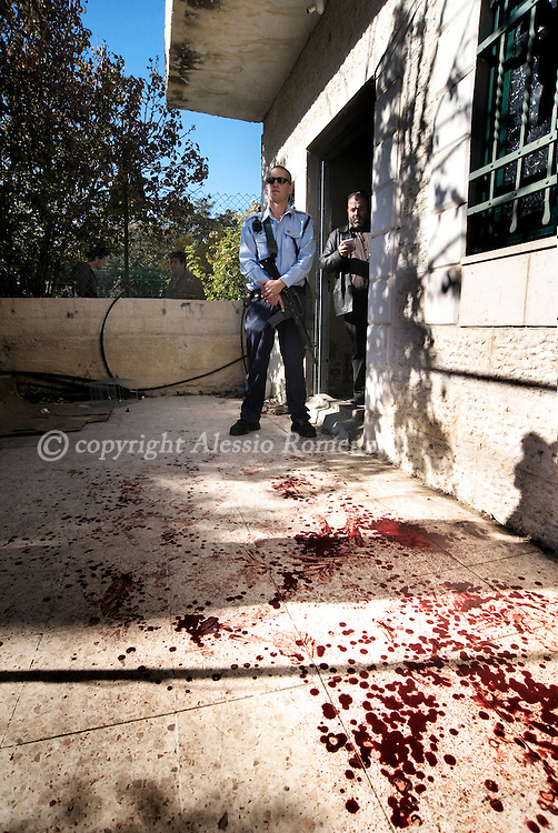 Blood stains the entrance of a Palestinian house in the east Jerusalem neighborhood of Sheikh Jarrah, Tuesday, Dec. 1, 2009. In an unrest Tuesday, a Jewish family took over a house in an Arab neighborhood of east Jerusalem, sparking a protest by rock-throwing Palestinians and a few Israeli and foreign activists who joined them, police said. One of the family members was lightly injured in the head when a protester hit him with a metal bar, and police arrested five people. Both sides claim ownership of the building. ..© ALESSIO ROMENZI