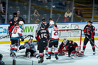 KELOWNA, CANADA - FEBRUARY 20:  Ted Brennan #10 and Cal Foote #25 skated to Erik Gardiner #12 of the Kelowna Rockets as he sits on the ice after scoring a second period goal during a fall on Taylor Gauthier #35 of the Prince George Cougars on February 20, 2018 at Prospera Place in Kelowna, British Columbia, Canada.  (Photo by Marissa Baecker/Shoot the Breeze)  *** Local Caption ***