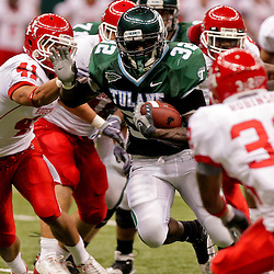 Oct 17, 2009; New Orleans, LA, USA; Tulane Green Wave running back Andre Anderson (32) breaks away from Houston Cougars defenders Nick Saenz (41) and Jamal Robinson (32) during a game at the Louisiana Superdome. Houston defeated Tulane 44-16.   Mandatory Credit: Derick E. Hingle-US PRESSWIRE