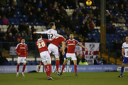 Danny Rose of Bury challenges for a high ball during the Sky Bet League 1 match between Bury and Barnsley at The JD Stadium, Bury, England on 23 February 2016. Photo by Simon Brady.