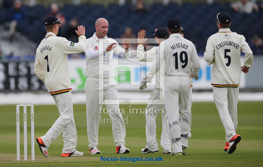 Chris Rushworth (2nd left) of Durham is congratulated on the wicket of Alex Hales (not shown) of Nottinghamshire during the LV County Championship Div One match at Emirates Durham ICG, Chester-le-Street<br /> Picture by Simon Moore/Focus Images Ltd 07807 671782<br /> 10/05/2015