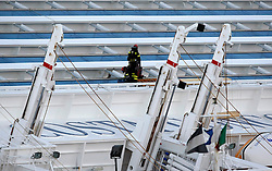 Fire fighter rescuers work on the cruise liner Costa Concordia which ran aground off the west coast of Italy at Giglio island January 25, 2012. The captain of the Italian liner Costa Concordia said he was told by managers to take his ship close to shore on the night it ran aground and capsized, but the company denied having any prior knowledge of the manoeuvre.<br /> REUTERS/Darrin Zammit Lupi (ITALY)