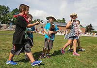 Jonathan, Aiden, Aaron, Audrey and Jennifer find gold in the Pleasant Street School fields during their Gold Rush on Thursday afternoon.  (Karen Bobotas/for the Laconia Daily Sun)