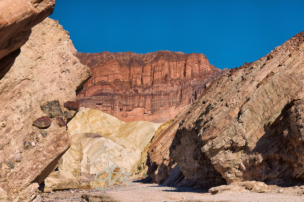 The striking sandstone of the Red Cathedral framing the Golden Canyon vista.