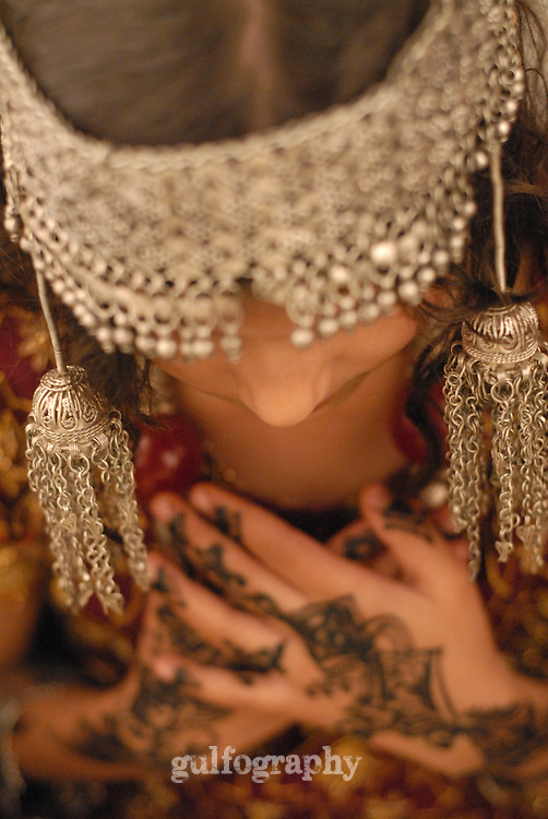 """""""Devoted"""" by Amira Al Sharif.  Girl in Yemen wearing traditional clothing with silver."""