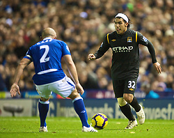 BIRMINGHAM, ENGLAND - Sunday, November 1, 2009: Manchester City's Carlos Tevez in action against Birmingham City during the Premiership match at St Andrews. (Pic by David Rawcliffe/Propaganda)