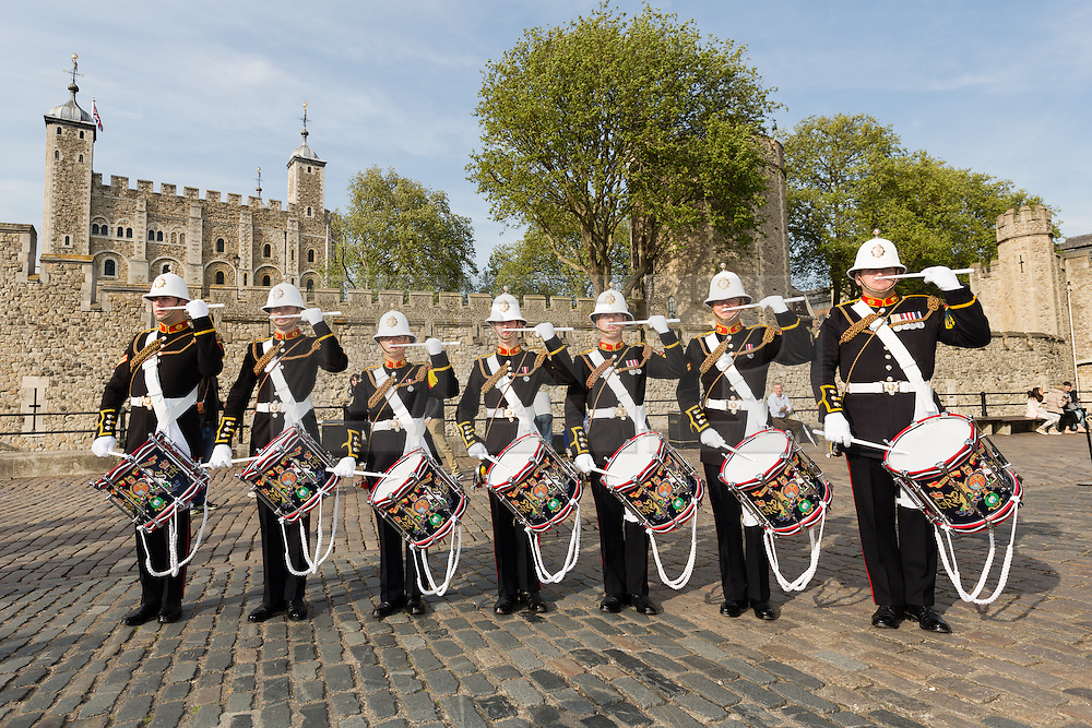 © Licensed to London News Pictures. 30/04/2014. London, UK. Royal Marines perform outside the Tower of London on 30th April 2014. The Royal Marines Corps of Drums are attempting to break the World record for the longest continuous drum roll as part of a year of celebrations to mark the 350th anniversary of the Royal Marines and raising money for the Royal Marines Charitable Trust Fund.  The current record stands at 28 hours, 19 minutes and 3 seconds and they hope to extend this to 64 hours. Photo credit : Vickie Flores/LNP