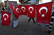 INSTANBUL, TURKEY - 22-11-2003:Woman selling Turkish flags at Taksim square in Istanbul a few days after the bombings on the British embassy and the HSB bank on November 20. The bombings have stronged the feelings of nationalism amongst the Turkish citizins.