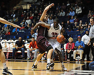 "Ole Miss' Reggie Buckner (23) drives around Louisiana-Monroe's Fabio Ribeiro (41) at the C.M. ""Tad"" Smith Coliseum in Oxford, Miss. on Friday, November 11, 2011.  Ole Miss won 60-38 in the season opener."