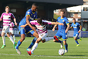Semi Ajayi of AFC Wimbledon stops Luke Gambin during the Sky Bet League 2 match between AFC Wimbledon and Barnet at the Cherry Red Records Stadium, Kingston, England on 3 October 2015. Photo by Stuart Butcher.