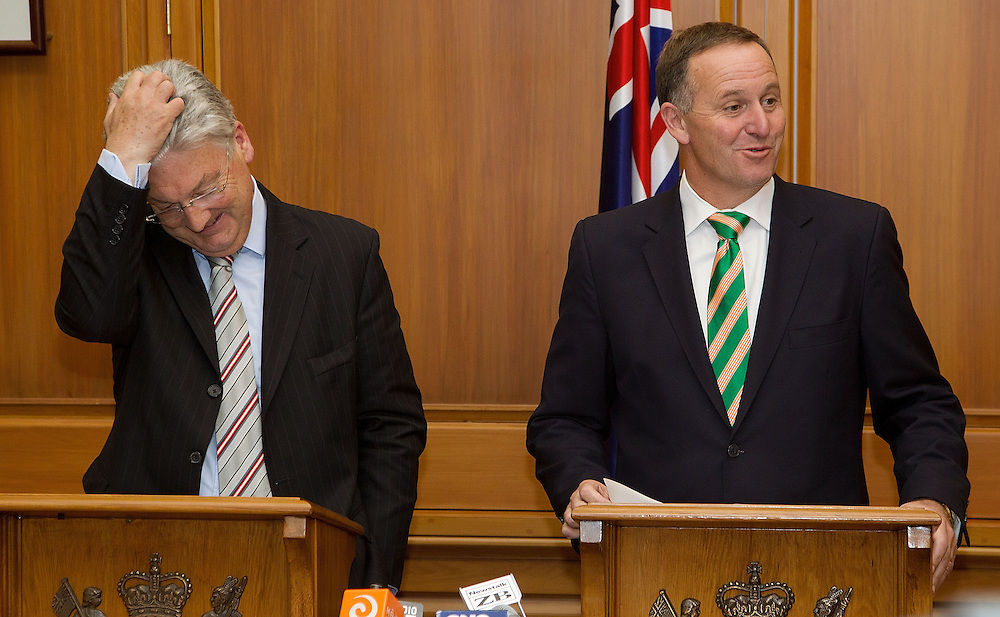 New Zealand Prime Minister John Key speaks to the media with Peter Dunne leader of the United Future party about a coalition agreement at Parliament in Wellington, New Zealand, Monday, December 05, 2011. Credit: SNPA / Marty Melville